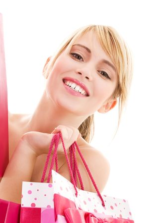 happy teenage girl with pink shopping bags Stock Photo - 4516044
