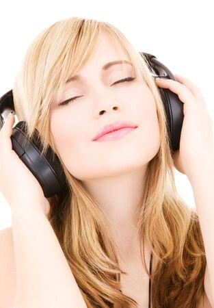 happy teenage girl in headphones over white Stock Photo - 4516072
