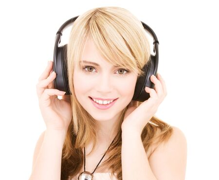 happy teenage girl in headphones over white Stock Photo - 4516064