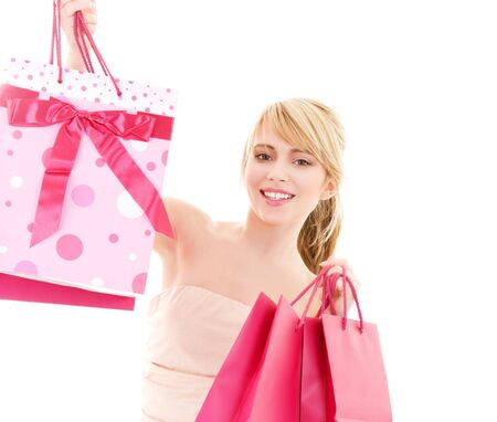 happy teenage girl with pink shopping bags Stock Photo - 4516047