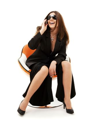 businesswoman with phone in orange chair over white Stock Photo - 4523443