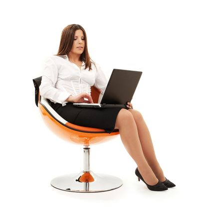 businesswoman in chair with laptop computer over white Stock Photo - 4523452