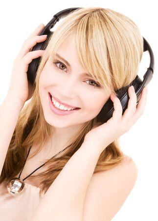 happy teenage girl in headphones over white Stock Photo - 4530851