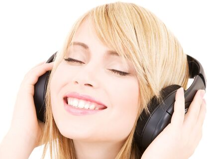 happy teenage girl in headphones over white Stock Photo - 4530848
