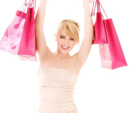 happy teenage girl with pink shopping bags Stock Photo - 4530825