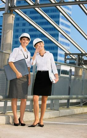 young female contractors in a front of building site Stock Photo - 4530850
