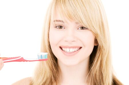 picture of happy girl with toothbrush over white Stock Photo - 4593735