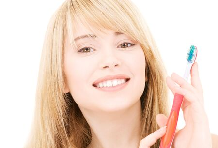 picture of happy girl with toothbrush over white Stock Photo - 4593742