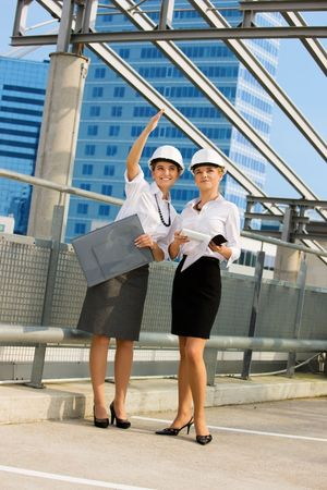 young female contractors in a front of building site Stock Photo - 4562559