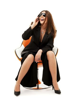 businesswoman with phone in orange chair over white Stock Photo - 4573415