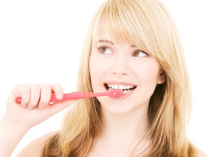 picture of happy girl with toothbrush over white