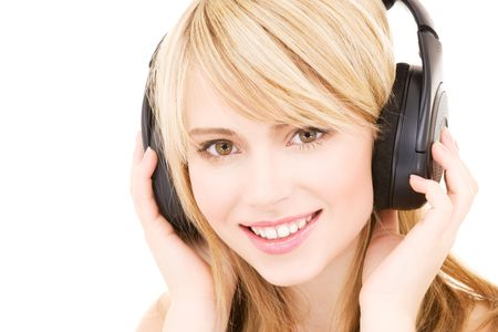 happy teenage girl in headphones over white Stock Photo - 4573437