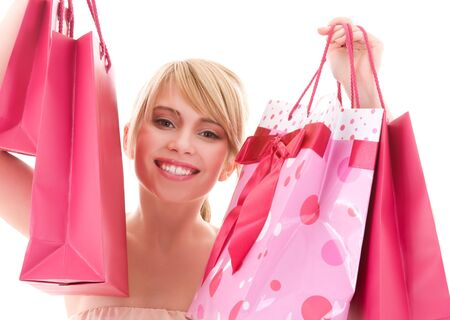 happy teenage girl with pink shopping bags Stock Photo - 4573424