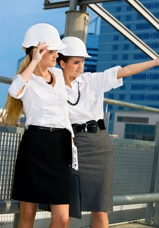 young female contractors in a front of building site Stock Photo - 4584688