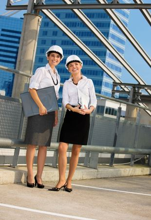 young female contractors in a front of building site Stock Photo - 4584689