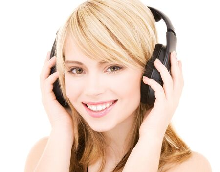 happy teenage girl in headphones over white Stock Photo - 4614316