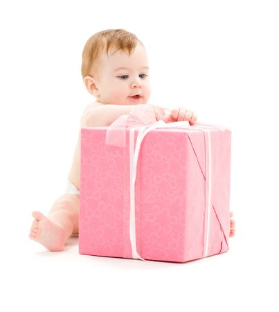 baby sit: picture of baby boy with big gift box