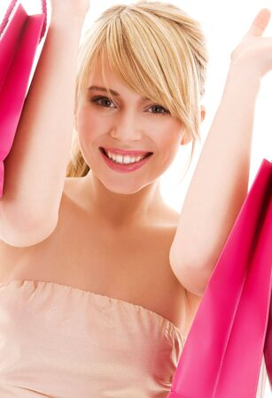 happy teenage girl with pink shopping bags Stock Photo - 4652952