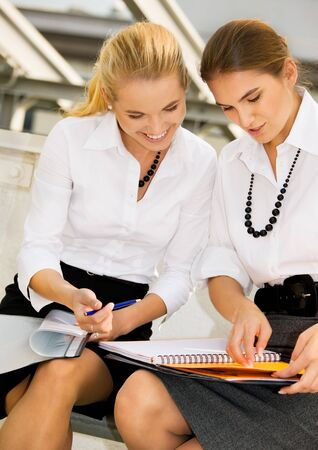 picture of two happy businesswomen with documents Stock Photo - 4652951