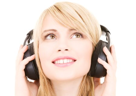 happy teenage girl in headphones over white Stock Photo - 4690240