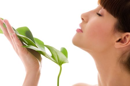 rejuvenating: picture of woman with green leaf over white