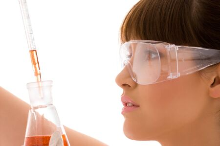closeup of beautiful lab worker holding up test tube Stock Photo - 4661628