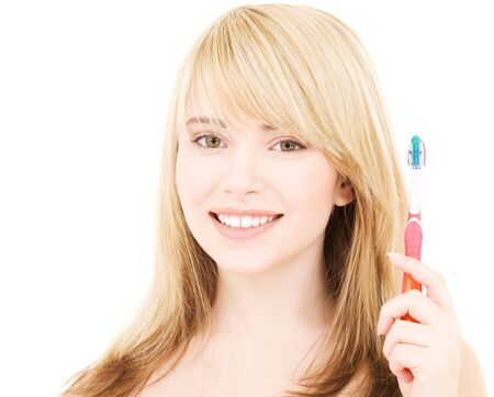 picture of happy girl with toothbrush over white Stock Photo - 4670089