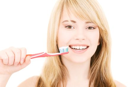 oral care: picture of happy girl with toothbrush over white