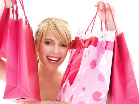 happy teenage girl with pink shopping bags Stock Photo - 4670092