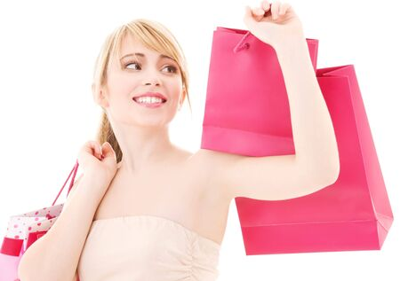 happy teenage girl with pink shopping bags Stock Photo - 4670087