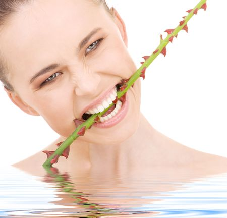 thorns  sharp: beautiful woman biting sharp thorns in water LANG_EVOIMAGES