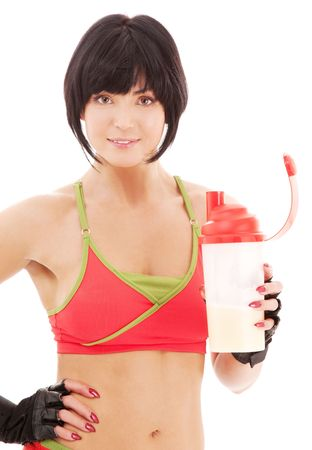 lovely fitness instructor with protein shake bottle Stock Photo - 4779987
