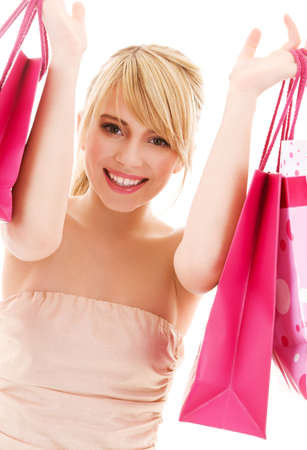 happy teenage girl with pink shopping bags Stock Photo - 4780047