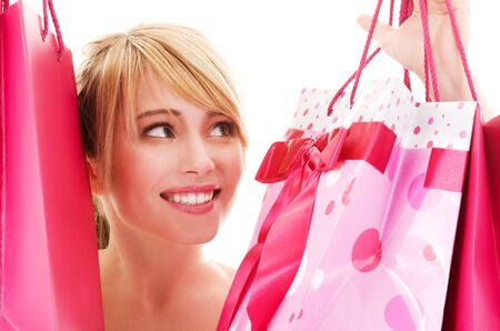 happy teenage girl with pink shopping bags Stock Photo - 4780029