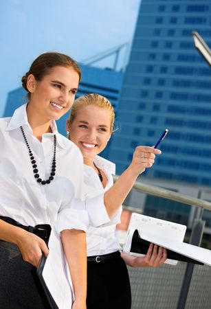 picture of two happy businesswomen (focus on blonde) photo