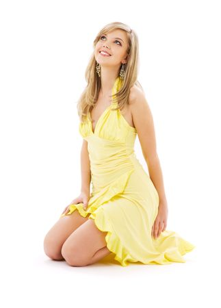 lovely girl in yellow dress over white Stock Photo - 4800523