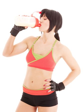 lovely fitness instructor with protein shake bottle Stock Photo - 4800524