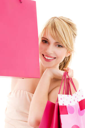 happy teenage girl with pink shopping bags Stock Photo - 4817126