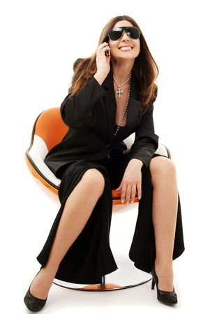 businesswoman with phone in orange chair over white Stock Photo - 4817114
