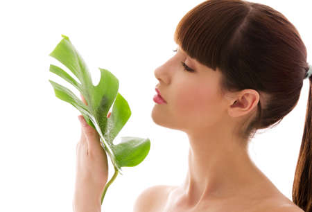 picture of woman with green leaf over white Stock Photo - 4835783