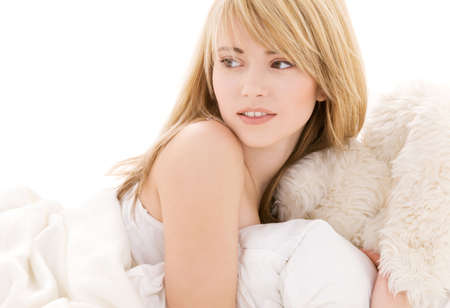 bright picture of lovely teenage girl in bed Stock Photo - 4870291