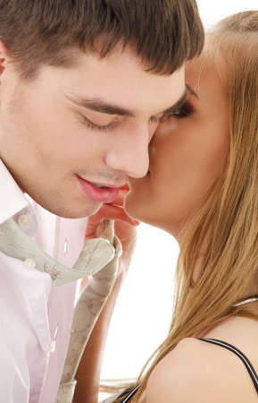 secret love: picture of couple in love over white (focus on lips)