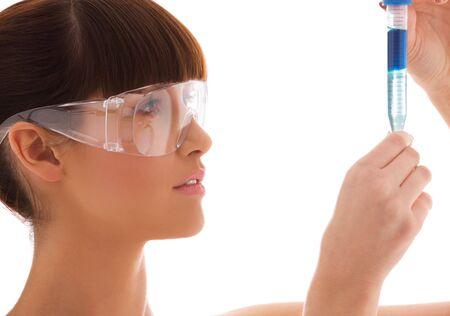 beautiful female lab worker holding up test tube Stock Photo - 4870314