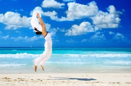 happy woman with white sarong on the beach Stock Photo - 4878849