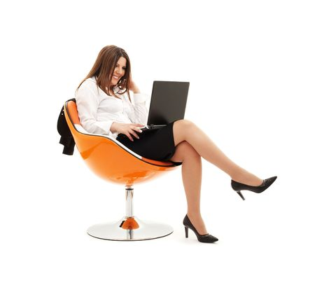 businesswoman in chair with laptop computer over white photo