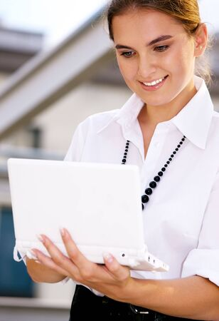 picture of happy businesswoman with laptop computer Stock Photo - 4878850