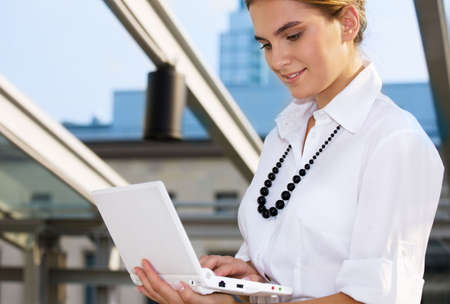 picture of happy businesswoman with laptop computer Stock Photo - 4878865