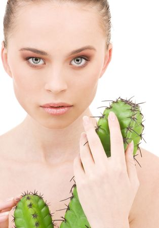 women face stare: closeup portrait of beautiful woman with cactus
