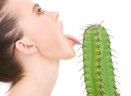 vicious: portrait of beautiful woman licking sharp cactus thorns LANG_EVOIMAGES