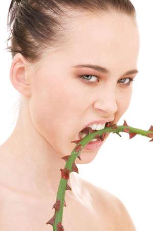 closeup portrait of beautiful woman biting sharp thorns Stock Photo - 4894027
